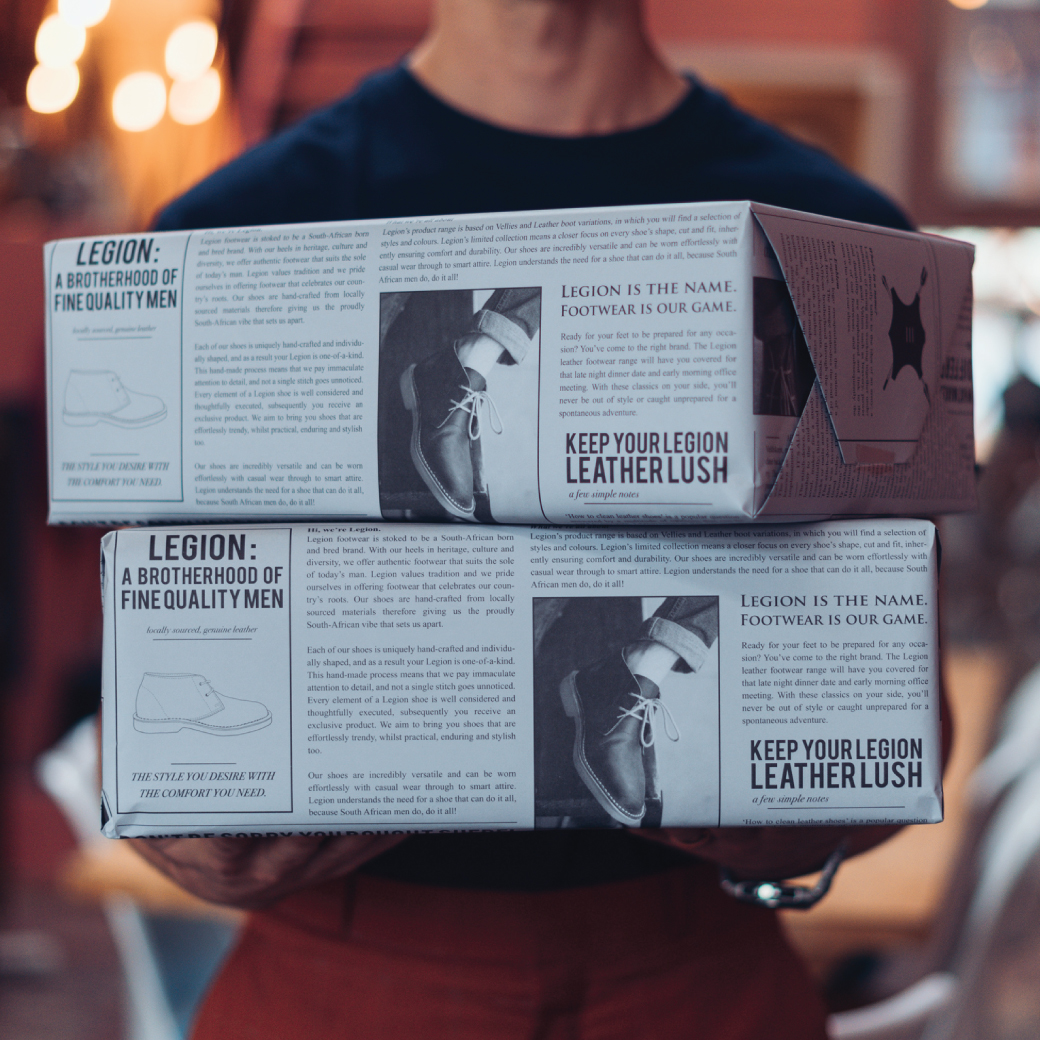 man holding wrapped Legion boxes