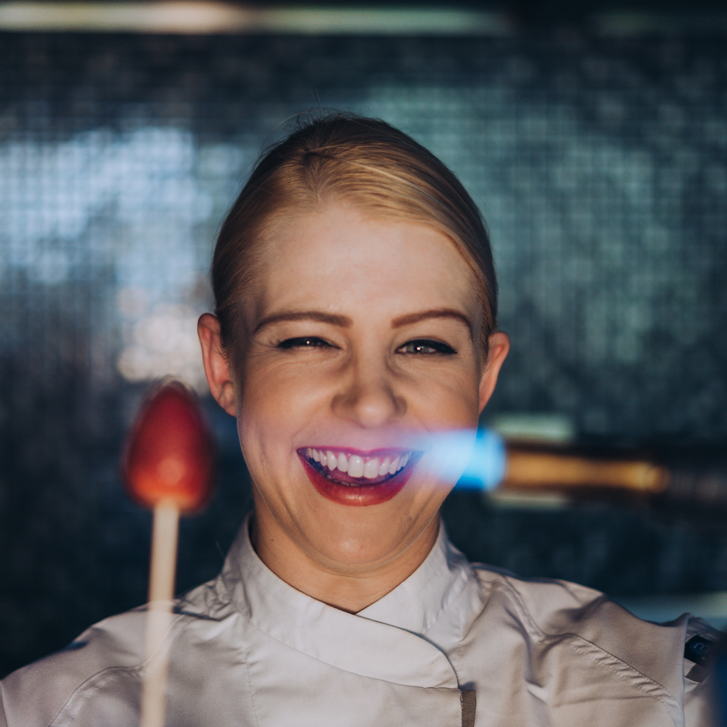 female chef using blow torch